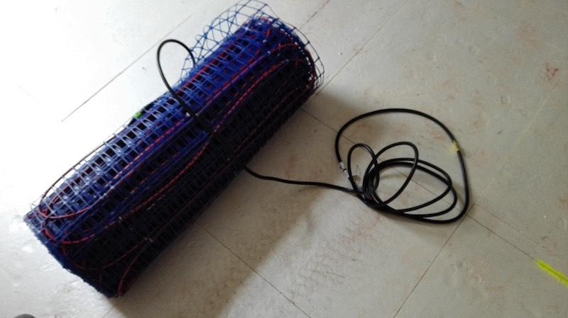 chauffage électrique au sol conditionné sous forme de rouleau
